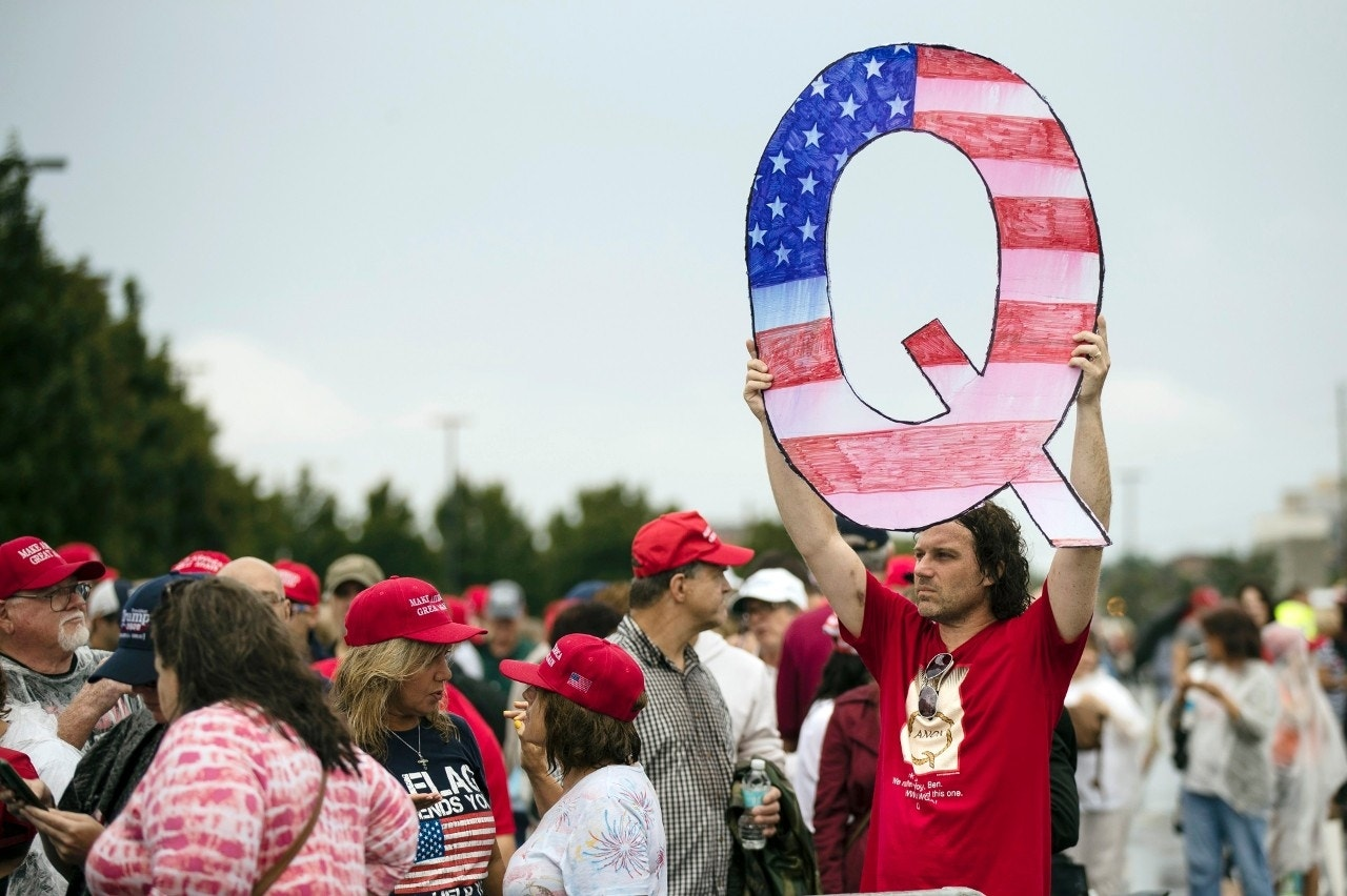 What is QAnon, the conspiracy theory group showing up to Trump rallies?
