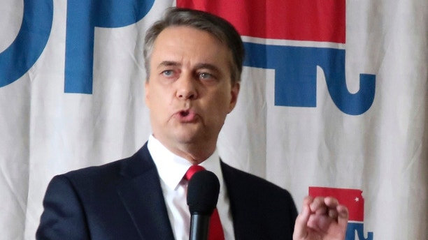 FILE - In this June 23, 2018, file photo, Kansas Gov. Jeff Colyer speaks during a Republican gubernatorial primary debate, in Salina, Kan. Conservative hardliner Kris Kobach is relying on his running mate to finance his campaign to unseat Gov. Colyer in the state's Republican primary. Campaign finance reports available online Tuesday, July 31, 2018, show that Kobach's choice for lieutenant governor, Wink Hartman, has loaned their campaign more than $1.5 million since April. It's the bulk of the $1.7 million raised by Kobach's campaign since the year started. (AP Photo/John Hanna, File)