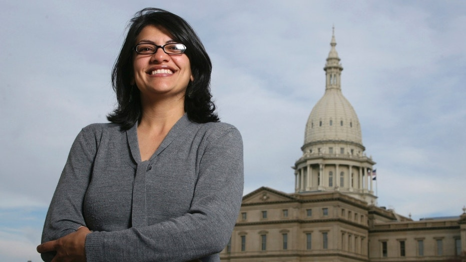 Rashida Tlaib, a Democrat, is photographed outside the Michigan Capitol in Lansing, Mich., Nov. 6, 2008. In the primary election Tuesday, Aug. 7, 2018, Democrats pick former Michigan state Rep. Rashida Tlaib to run unopposed for the congressional seat that former Rep. John Conyers held for more than 50 years. Tlaib would be the first Muslim woman in Congress.