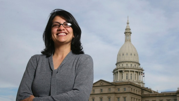 FILE - In this Nov. 6, 2008 file photo, Rashida Tlaib, a Democrat, is photographed outside the Michigan Capitol in Lansing, Mich. The Michigan primary victory of Tlaib, who is expected to become the first Muslim woman and Palestinian-American to serve in the U.S. Congress, is rippling across the Middle East. In the West Bank village where Tlaib's mother was born, residents are greeting the news with a mixture of pride and hope that she will take on a U.S. administration widely seen as hostile to the Palestinian cause. (AP Photo/Al Goldis, File)
