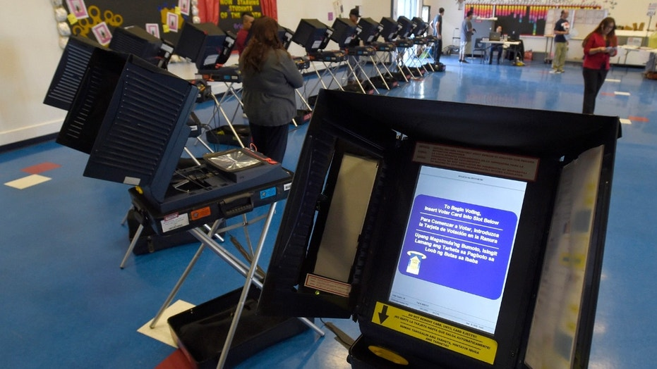 Voting machines set up for people to cast their ballots during the 2016 presidential election in Las Vegas.