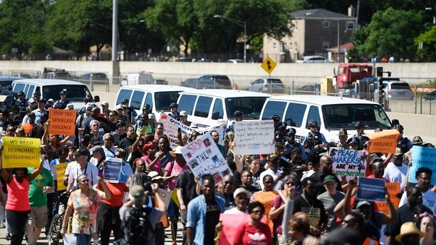 FILE - In this July 7, 2018, photo, protesters march on the Dan Ryan Expressway in Chicago. The protesters shut down the expressway in an attempt to increase pressure on public officials to address the gun violence that's claimed hundreds of lives in some of the city's poorest neighborhoods. Chicago officials have issued parking bans and are warning motorists of rolling street closures ahead of a rush-hour protest march along the city's always busy Lake Shore Drive. Protesters plan to gather on the thoroughfare Thursday afternoon, Aug. 2 and march north toward Wrigley Field. (AP Photo/Annie Ricem, File)
