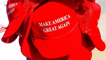 "Sarasota, FL, USA - November 28, 2015: Donald Trump for President ""Make America Great Again"" red baseball hats on sale at his Presidential candidate tour stop in Sarasota FL"