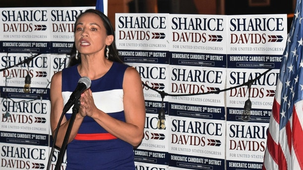 Sharice Davids addresses her supporters at Breit's Stein and Deli in Kansas City, Kan., Tuesday, Aug. 7, 2018. Davids, a Democrat, is running for a seat in Kansas' 3rd Congressional District. (Luke Harbur/The Kansas City Star via AP)