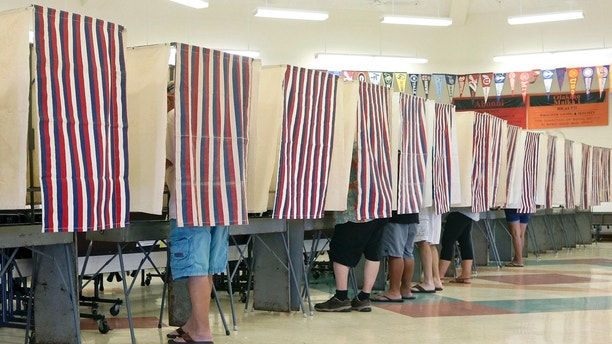 A small surge of voters take to the polls, Saturday, Aug. 11, 2018, at Chiefess Kamakahelei Middle School, in Puhi, Kauai, Hawaii. Hawaii voters headed to the polls  for a primary election that will most likely settle the outcome of this year's major races. (Dennis Fujimoto /The Garden Island via AP)