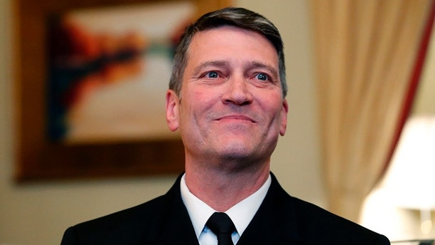 FILE - In this April 16, 2018, file photo, U.S. Navy Rear Adm. Ronny Jackson, M.D., left, sits with Sen. Johnny Isakson, R-Ga. , chairman of the Veteran's Affairs Committee, before their meeting on Capitol Hill in Washington.