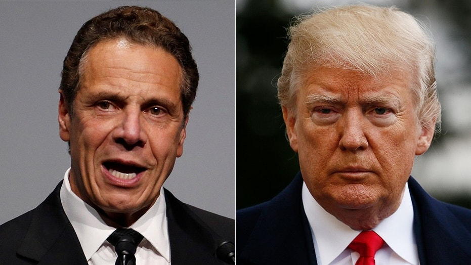 President Trump, speaking during a fundraiser Monday with New York Republicans, dared Democratic Gov. Andrew Cuomo, left, to run against him for president in 2020.