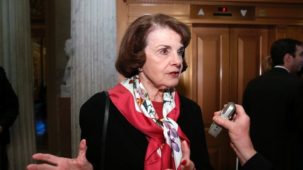 Sen. Dianne Feinstein, D-Calif., speaks with a reporter on Capitol Hill, Tuesday, Dec. 19, 2017 in Washington. (AP Photo/Alex Brandon)