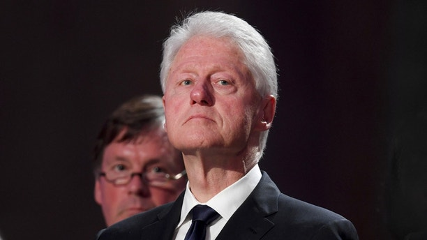 Former U.S. president Bill Clinton attends a pontifical requiem mass for late former German Chancellor Helmut Kohl in the cathedral in Speyer, Germany, July 1, 2017.  REUTERS/Arne Dedert/Pool - RC170187E1C0