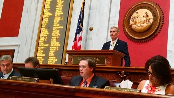 West Virginia House Speaker Pro Tempore John Overington, top, presides over the start of a hearing Monday, Aug. 13, 2018, at the state Capitol in Charleston, W. Va. The House of Delegates is considering the impeachment of the entire state Supreme Court in a scandal over $3.2 million in office renovations. (AP Photo/John Raby)