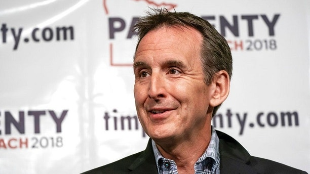 FILE - In this May 31, 2018, file photo, former Minnesota Gov. Tim Pawlenty speaks at a news conference in St. Paul, Minn. Minnesota Democrats are settling a three-way battle for governor in a stacked primary election, while former two-term Gov. Tim Pawlenty is seeking to win back his old job on the Republican side. (Glen Stubbe/Star Tribune via AP, File)