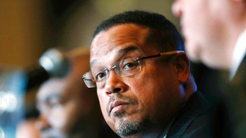 FILE - In this Dec. 2, 2016, file photo, U.S. Rep. Keith Ellison, D-Minn., listens during a forum on the future of the Democratic Party, in Denver. On Sunday, Aug. 12, 2018, Ellison denied an allegation from an ex-girlfriend that he had once dragged her off a bed while screaming obscenities at her. The allegation came just days before a Tuesday primary in which the Democrat is among several running for state attorney general. (AP Photo/David Zalubowski, File)
