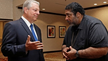 "Former U.S. Vice President Al Gore, left, speaks with the Rev. Dr. William J. Barber II in Greensboro, N.C., Monday, Aug. 13, 2018. The former vice president joins Rev. Barber for an ""ecological justice organizing tour"" as a part of The Poor People's Campaign. (AP Photo/Gerry Broome)"