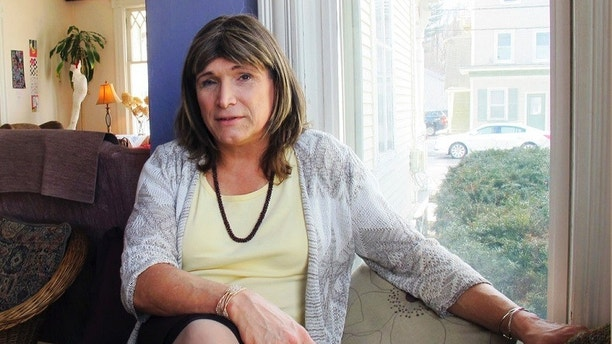 File - In this Feb. 21, 2018 file photo, transgender utility executive Christine Hallquist poses for a photo during an interview in Johnson, Vt. Hallquist is one of four Democrats seeking the party's nomination for Vermont governor in the Tuesday, Aug. 14 primary election.