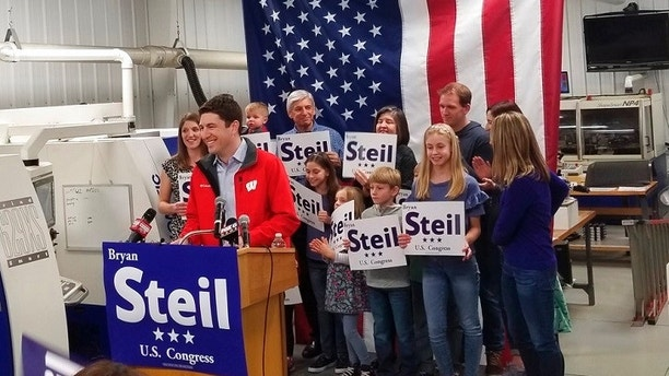 FILE - In this Sunday, April 22, 2018, file photo, attorney Bryan Steil, a former driver for House Speaker Paul Ryan, announces he is running to succeed Ryan in Congress,  in Janesville, Wis. House Speaker Paul Ryan's retirement creates an opening in his southeastern Wisconsin congressional district for the first time in 20 years, fueling hopes among Democrats that they can pick up the seat that leans Republican. (Jake Magee/The Janesville Gazette via AP, File)