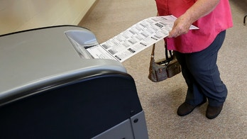 Paula Nicholson, of rural Kieler, Wis., casts her ballot at Jamestown Town Hall in Kieler on Tuesday, Aug. 14, 2018. Residents headed to the polls across the state to vote in Wisconsin's primary election. (Nicki Kohl/Telegraph Herald via AP)