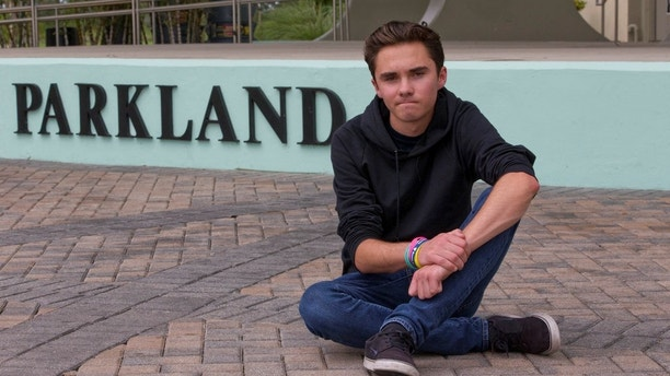 David Hogg, a senior at Marjory Stoneman Douglas High School, poses for a photo at Pine Trails Park, Tuesday, May 29, 2018, in Parkland, Fla. Hogg, one of the leaders of the March For Our Lives movement, is spearheading the national effort to register young voters along with the New York-based organization HeadCount. They say students at more than 1,000 schools in 46 states are participating, with most starting their drives Tuesday. (AP Photo/Wilfredo Lee)