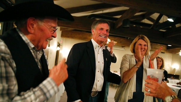 Gubernatorial candidate and Wyoming Secretary of State Mark Gordon celebrates with supporters as poll numbers are finalized during Gordon's election night party at Bozeman Trail Steakhouse in Buffalo, Wyo., Tuesday, Aug. 21, 2018. Gordon won a fiercely contested GOP primary to replace Republican Gov. Matt Mead.  (Josh Galemore/The Casper Star-Tribune via AP)