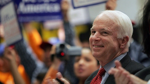 Senator John McCain (R-AZ) smiles during a rally in support of the 'Secure America and Orderly Immigration Act of 2005' in New York February 27, 2006.  The legislation, of which McCain is a co-sponsor, opens an avenue to citizenship for undocumented immigrants already in the United States and makes allowances for those that still want to enter the country.  REUTERS/Seth Wenig - GM1DSBBELLAA