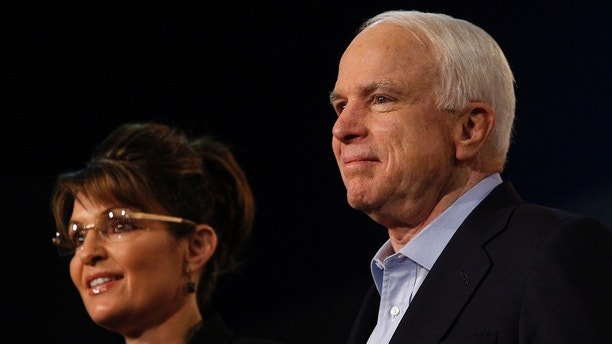 Former Alaska governor and vice presidential candidate Sarah Palin and U.S. Senator John McCain (R-AZ) attend a campaign rally for McCain at Dobson High School in Mesa, Arizona March 27, 2010. McCain who is seeking a fifth term as U.S. Senator received Palin's endorsement yesterday and will challenge JD Hayworth during the Republican primary in August 2010. REUTERS/Joshua Lott (UNITED STATES - Tags: POLITICS) - GM1E63S09CY01