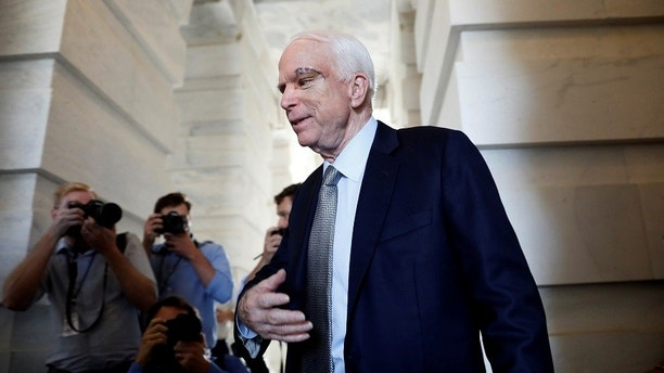 Senator John McCain (R-AZ), recently diagnosed with an aggressive form of brain cancer, departs after returning to the Senate to vote on health care legislation on Capitol Hill in Washington, U.S., July 25, 2017. REUTERS/Aaron P. Bernstein - RC177E492F10
