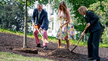 From left, President James Monroe's fifth generation grandson Richard Emory Gatchell, Jr., first lady Melania Trump, and President Dwight Eisenhower's granddaughter Mary Jean Eisenhower, participate in a presidential tree planting ceremony on the South Lawn of the White House, Monday, Aug. 27, 2018, in Washington. The sapling was grown from the Eisenhower Oak and replaces a tree which blew down during a windstorm earlier this year. Additionally, this year marks the 200th anniversary of President Monroe's family moving back into the White House after the British set fire to it during the War of 1812. (AP Photo/Andrew Harnik)