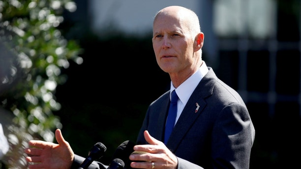 FILE PHOTO: Florida Governor Rick Scott speaks about hurricane relief measures for Florida and Puerto Rico at the White House in Washington, U.S., September 29, 2017. REUTERS/Joshua Roberts/File Photo - RC1DCE980020