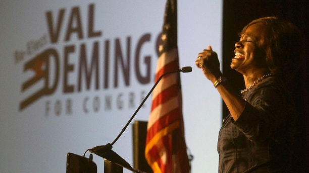 U.S. Rep. Val Demings gives an emotional re-election speech honoring the late Senator John McCain Tuesday, Aug. 28, 2018, in Orlando, Fla. The Orlando Democrat on Tuesday defeated Wade Darius in the primary.  (Red Huber/Orlando Sentinel via AP)