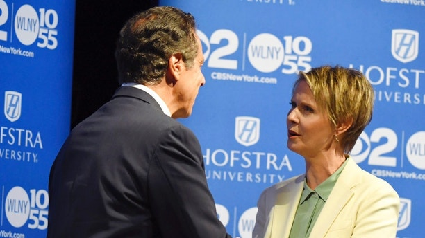 New York Gov. Andrew M. Cuomo and Cynthia Nixon shake hands at Hofstra University in Hempstead on Wednesday, Aug. 29, 2018 ahead of their the Democratic gubernatorial primary debate. The winner of the Democratic primary faces Republican Marc Molinaro and independent Stephanie Miner in November 2018. (J. Conrad Williams Jr./Newsday via AP, Pool)