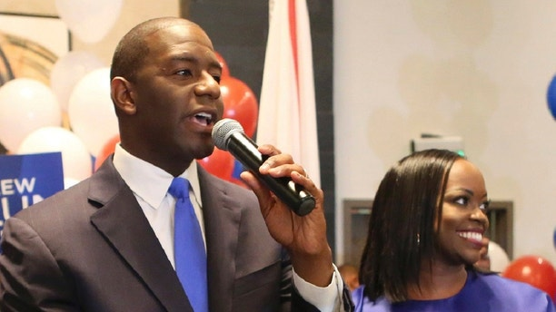 Andrew Gillum and his wife, R. Jai Gillum addresses his supporters after Andrew Gillum won the Democratic primary for governor on Tuesday, Aug. 28, 2018, in Tallahassee, Fla. Gillum defeated former U.S. Rep. Gwen Graham, the daughter of former U.S. Sen. Bob Graham and four other candidates. (AP Photo/Steve Cannon)