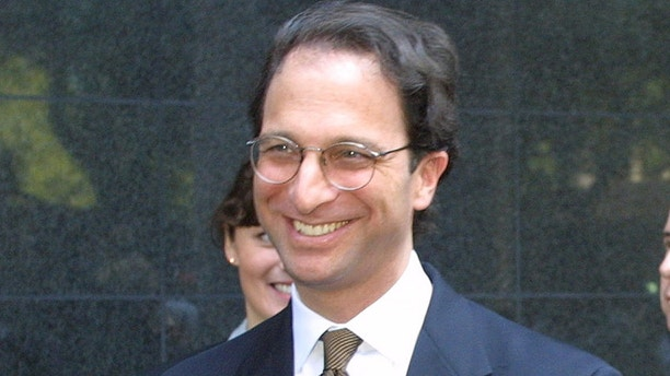 Federal prosecutors Andrew Weissman (L) and Leslie Caldwell smile outside federal court in Houston June 15, 2002 after a jury found the Andersen accounting firm guilty of obstructing justice in an investigation of its client, Enron Corporation. The 12-member jury, which heard nearly five weeks of testimony before U.S. District Judge Melinda Harmon, found Andersen criminally intended to keep Enron audit records away from a U.S. Securities and Exchange Commission inquiry. REUTERS/Richard Carson RJC/GN - RP3DRHZYNHAB