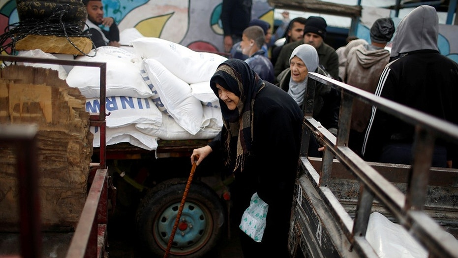 A Palestinian refugee leaves a United Nations food distribution center after receiving aid in Al-Shati refugee camp in Gaza City in January.