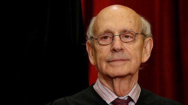 U.S. Supreme Court Justice Stephen Breyer participates in taking a new family photo with his fellow justices at the Supreme Court building in Washington, D.C., U.S., June 1, 2017. REUTERS/Jonathan Ernst - RC1D9F7ED140