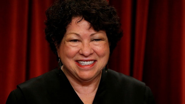 U.S. Supreme Court Justice Sonia Sotomayor participates in taking a new family photo with her fellow justices at the Supreme Court building in Washington, D.C., U.S., June 1, 2017. REUTERS/Jonathan Ernst - RC12A0609960