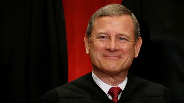 U.S. Chief Justice John Roberts participates in taking a new family photo with his fellow justices at the Supreme Court building in Washington, D.C., U.S., June 1, 2017.  REUTERS/Jonathan Ernst - RC1E9164F080