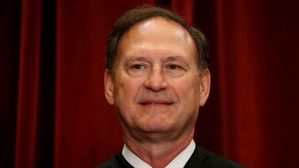 U.S. Supreme Court Justice Samuel Alito participates in taking a new family photo with his fellow justices at the Supreme Court building in Washington, D.C., U.S., June 1, 2017. REUTERS/Jonathan Ernst - RC15DA3386A0