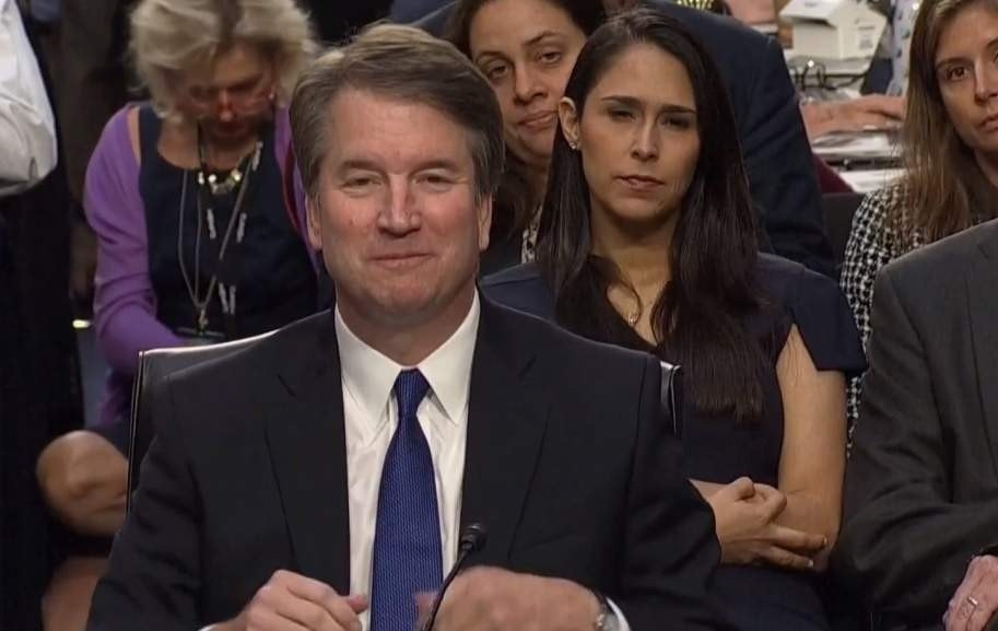 Social media users falsely accuse ex-Trump official of making 'white power' gesture at Kavanaugh hearing