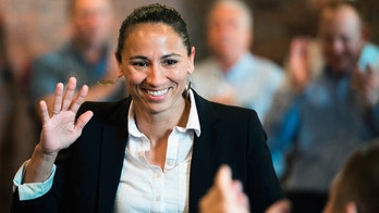 FILE - In this Aug. 8, 2018, file photo, Democrat Sharice Davids waves at her supporters at a Democratic event in Kansas City, Kan. An ad by Davids in Kansas 3rd Congressional District claiming she doesn't support abolishing ICE contradicts an earlier statement. Davids faces Republican Rep. Kevin Yoder in a district seen as a prime target for Democrats to flip. (Shelly Yang/The Kansas City Star via AP, File)