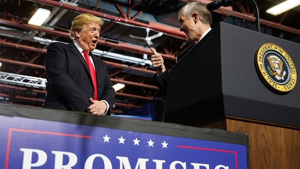 FILE - In this July 5, 2018, file photo, President Donald Trump looks to GOP Senate candidate Matt Rosendale, giving him the thumbs-up during a rally at the Four Seasons Arena at Montana ExpoPark, in Great Falls, Mont. Montana State Auditor Rosendale has made his support for Trump a centerpiece of his campaign to unseat U.S. Sen. Jon Tester. (AP Photo/Carolyn Kaster, File)