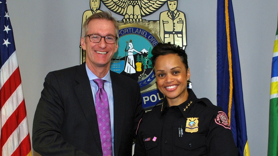 Portland Mayor Ted Wheeler and Chief Danielle Outlaw of the Portland Police Bureau are seen Oct. 2, 2017.