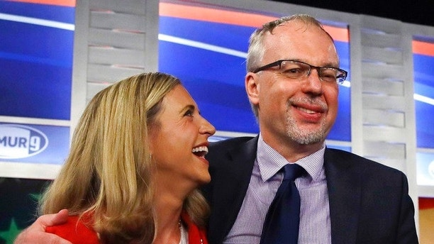 Levi Sanders, right, shares a laugh with Maura Sullivan following a debate for Democratic hopefuls in New Hampshire's 1st Congressional District at the Institute of Politics at St. Anselm College in Manchester, N.H., Wednesday, Sept. 5, 2018. (AP Photo/Charles Krupa, Pool)