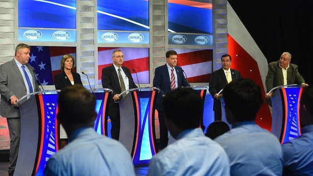 FILE - In this Sept. 7, 2018, file photo, from left, Republicans Bob Burns, Lynne Blankenbeker, Gerard Beloin, Stewart Levenson, Rep. Steve Negron, and Brian Belanger participate in the 2nd Congressional District debate at Saint Anselm College in Goffstown, N.H. The winner of the Tuesday, Sept. 11 primary will face Democrat U.S. Rep. Annie Kuster in the November general election. (Thomas Roy/The Union Leader via AP, Pool, File)