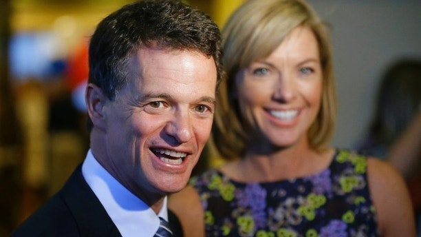 In this Aug. 5, 2014 file photo, Republican David Trott, a candidate for Michigan's 11th congressional district, stands next to his wife, Kappy, during an interview at his election night party in Troy, Mich. In a statement Monday, Sept. 11, 2017, Rep. Dave Trott, R-Mich., says he will not seek re-election. (AP Photo/Carlos Osorio)