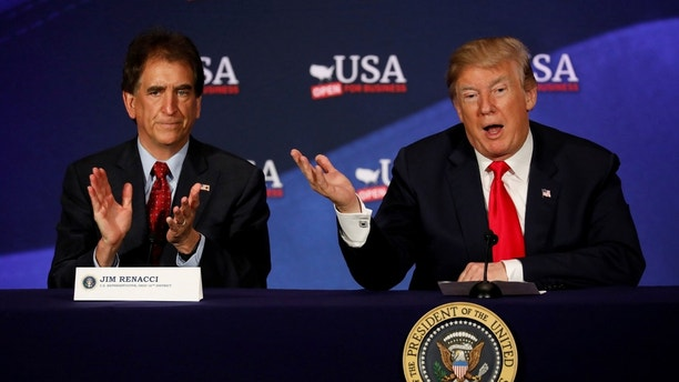President Donald Trump, accompanied by Rep. Jim Renacci (R-OH), speaks during a roundtable discussion on tax reform at the Cleveland Public Auditorium in Cleveland, Ohio, U.S., May 5, 2018. REUTERS/Aaron P. Bernstein - RC155F9B5980