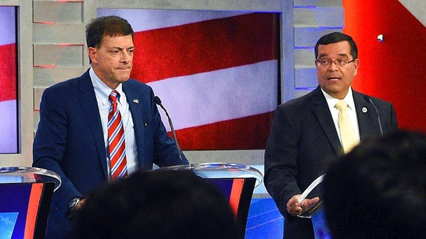 FILE - In this Sept. 7, 2018 file photo, New Hampshire Republicans Stewart Levenson, left, and state Rep. Steve Negron participate in the 2nd Congressional District debate at Saint Anselm College in Manchester, N.H. Levenson conceded the race to Negron in the Sept. 11 Republican primary. (Thomas Roy/The Union Leader via AP, Pool, File)