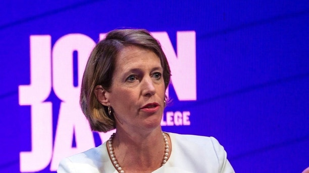 FILE - In this Aug. 28, 2018, file photo, candidate Zephyr Teachout stands at the podium during a debate by the Democratic candidates for New York State Attorney General at John Jay College of Criminal Justice in New York. The four candidates in the tightly contested primary, Teachout, Letitia James, U.S. Rep. Sean Patrick Maloney and Leecia Eve have all vowed to be a legal thorn in Republican President Donald Trump's side, opposing his policies on immigration and the environment. And the winner will inherit several pending lawsuits filed by the state that challenge Trump's policies and accuse his charitable foundation of breaking the law. (Holly Pickett/The New York Times via AP, Pool, File)