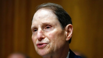 FILE - In this June 28, 2018, file photo, Sen. Ron Wyden, D-Ore., ranking member of the Senate Finance Committee, speaks during a hearing on the nomination of Charles Rettig for Internal Revenue Service Commissioner on Capitol Hill in Washington. Wyden is proposing new legislation that would allow the Senate's Sergeant at Arms to spend taxpayer money protecting senators' private email accounts and personal devices amid persistent anxieties over the digital security of the American midterm vote. (AP Photo/Jacquelyn Martin, File)