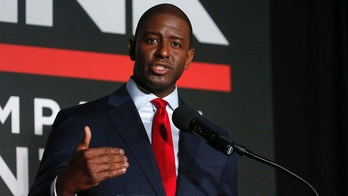 FILE - This July 18, 2018, file photo shows Tallahassee Mayor Andrew Gillum speaking during a Democratic gubernatorial debate held at Florida Gulf Coast University's Cohen Center in Fort Myers, Fla. Gillum, in an effort to answer lingering questions about trips he took that are being investigated by the state's ethics commission, released receipts on Monday, Sept. 3, 2018, that he says show he paid for his travel. Gillum, who last week won the Democratic primary for Florida governor, met Tuesday with investigators from Florida's ethics commission to discuss the trips to Costa Rica and New York City. (AP Photo/Wilfredo Lee, File