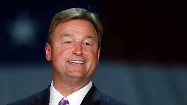 FILE--In this Sept. 7, 2018, file photo, Sen. Dean Heller, R-Nev, speaks during a visit by Vice President Mike Pence at Nellis Air Force Base in Las Vegas. Heller said Wednesday, Sept. 12, 2018, he's willing to bet $100 that the Senate will confirm Supreme Court nominee Brett Kavanaugh by the end of the month. But if there's any delay, he's confident the nominee will be confirmed before November's midterm elections. (Steve Marcus/Las Vegas Sun via AP, file)