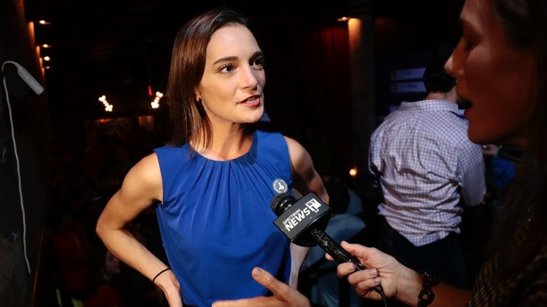 Julia Salazar, left, answers questions during an interview after winning the Democratic primary over Martin Dilan in New York's 18th State Senate district race, Thursday, Sept. 13, 2018, in New York. (AP Photo/Julie Jacobson)